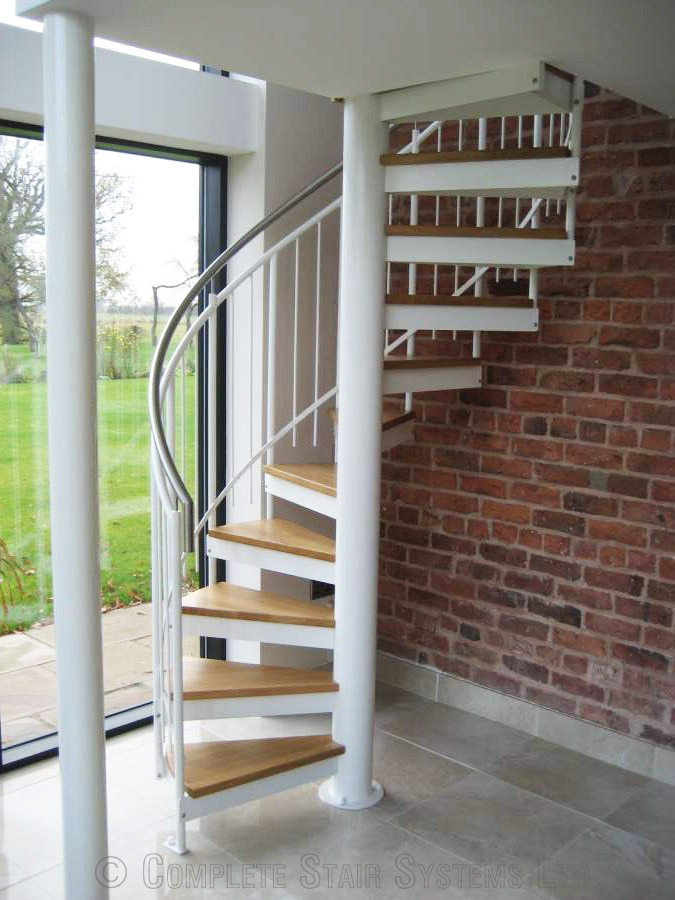 Bespoke spiral staircase chester accessing a mezzanine floor for Spiral stair