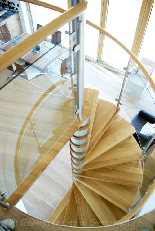 Spiral staircase ayrshire with curved glass panels for Build your own spiral staircase