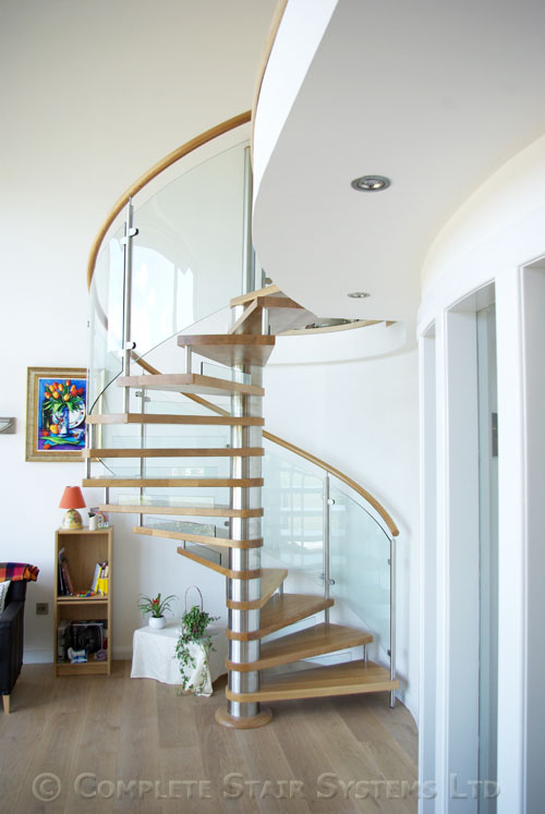 Spiral staircase ayrshire with curved glass panels for Curved staircase
