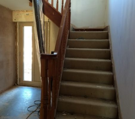 An old carpeted staircase before transformation