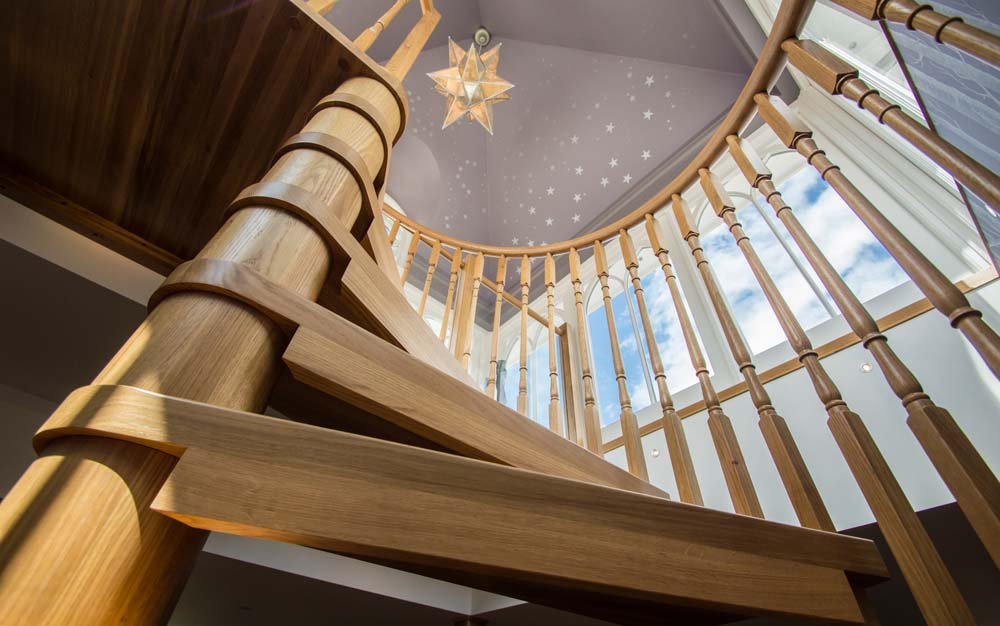A view looking up at a Model 71 spiral staircase in Tilford